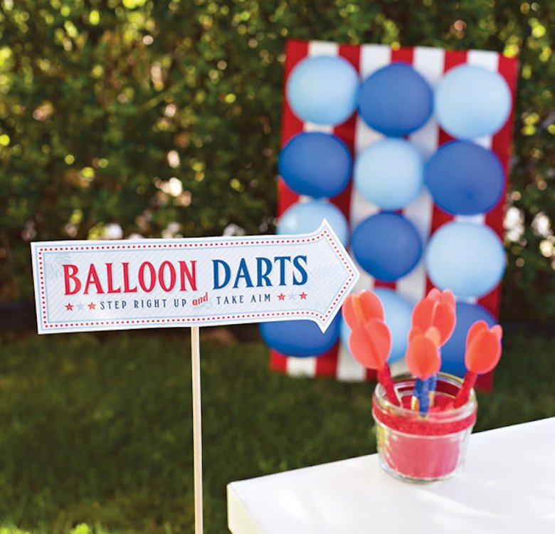 This patriotic, red, white and blue balloon darts game idea makes a fun Fourth of July activity for kids