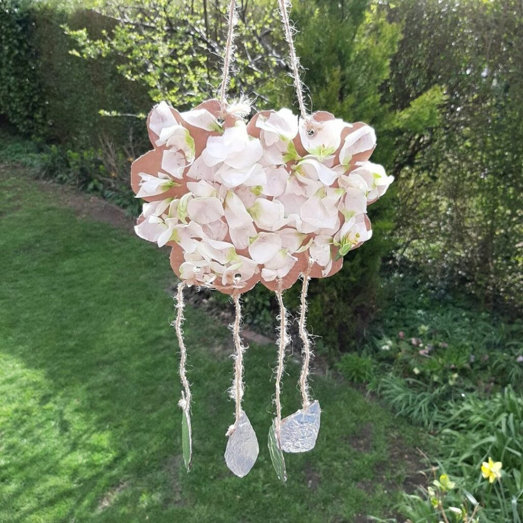 This DIY petal cloud craft makes a cool nature crafts for kids.