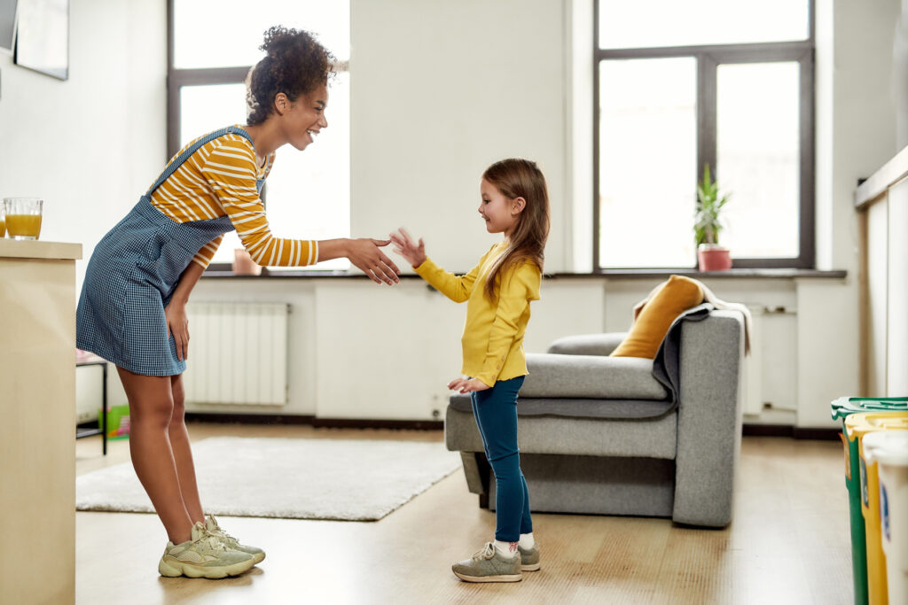 College student babysitter meeting young child at babysitting job