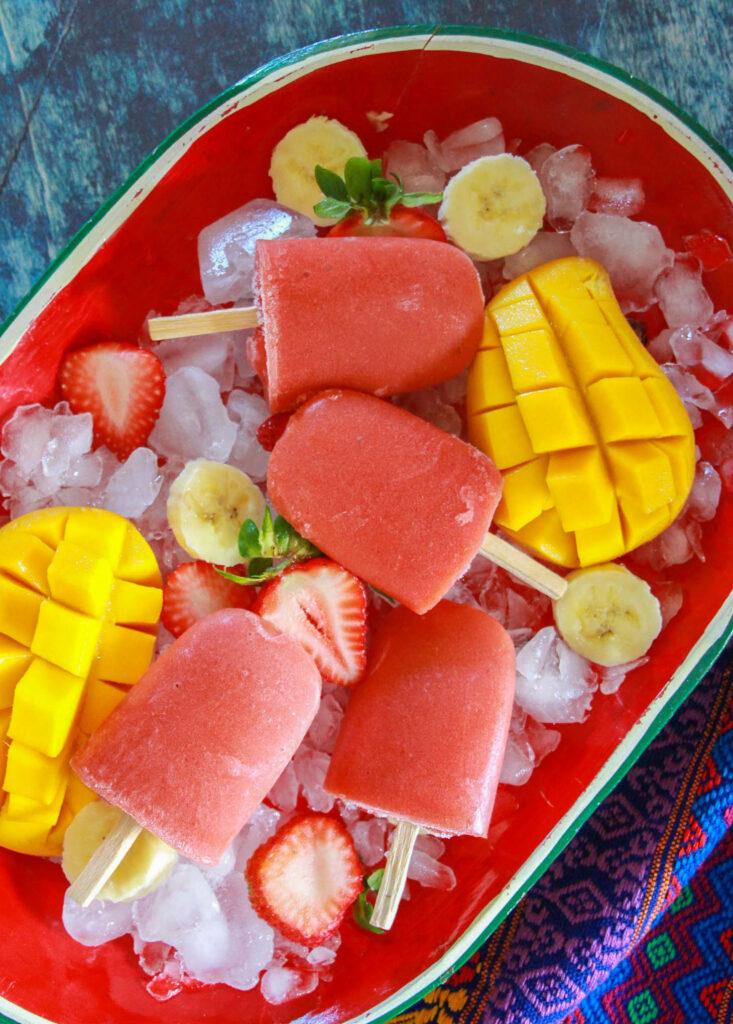 Making Strawberry Mango Banana Paletas is a fun way to celebrate National Hispanic Heritage Month with kids