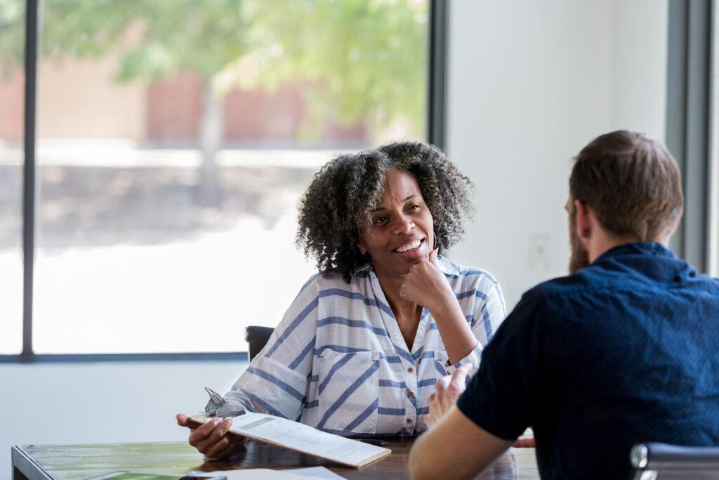 woman interviews potential companion caregiver