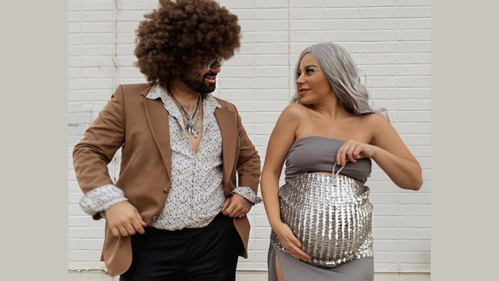 This Studio 54 disco ball bump idea makes the perfect Halloween costume for pregnant women