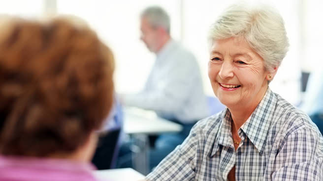elderly woman learning about housing options